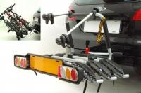 Peruzzo Автобагажник на фаркоп BOLOGNA, алюминий, откидной, для 3 в-дов весом до 15кг, фиксация велосипеда: колёса в полозе и за трубу рамы (max D:60 мм), цвет: серое защитное покрытие, упаковка-картонная коробка